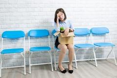 Азиатская коммерсантка увольнятьа стоковая фотография rf