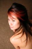 азиатская красивейшая девушка смотря бортова к Стоковое фото RF
