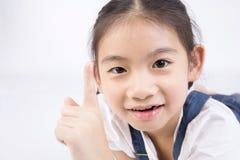 Азиатская милая девушка в костюме скачки с стороной улыбки Стоковые Фото