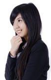 Азиатская милая сторона и взгляд улыбки девушки к левой стороне Стоковое фото RF