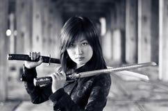 азиатская опасная девушка Стоковые Фотографии RF