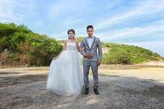 Азиатская пара сфотографированная перед замужеством Пре-свадьба на Koh Стоковая Фотография