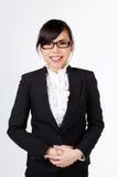Азиатская сторона улыбки женщины на белизне Стоковое фото RF