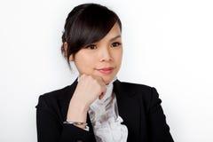 Азиатская сторона улыбки женщины на белизне Стоковые Фото