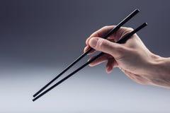 Азиатская традиция Азиатская еда с 2 палочками ручки Стоковое фото RF