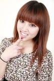 азиатская усмешка девушки Стоковая Фотография
