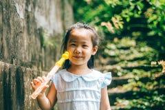 азиатская усмешка девушки Стоковая Фотография RF