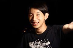 азиатская усмешка человека Стоковые Изображения