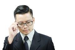Азиатские бизнесмены думают что-то Стоковые Фотографии RF
