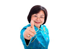 Азиатские большие пальцы руки женщины вверх Стоковая Фотография