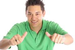 Азиатские большие пальцы руки человека вверх Стоковая Фотография