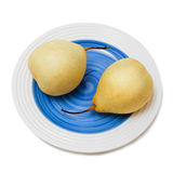 Азиатские груши на белой плите с нижней синью Стоковое фото RF