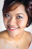 азиатские женские сверкная зубы белые стоковые изображения rf