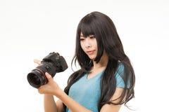 Азиатские женщина и камера Стоковые Изображения