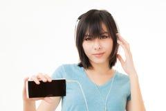 Азиатские женщина и наушники Стоковые Фото