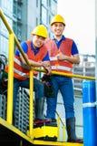 Азиатские индонезийские рабочий-строители Стоковое Изображение