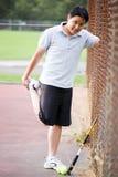 азиатские мыжские детеныши тенниса игрока Стоковое Фото