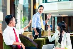 Азиатские предприниматели имея встречу Стоковая Фотография