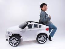 Азиатский автомобиль мальчика Стоковые Фотографии RF