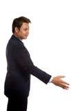 Азиатский бизнесмен в костюме предлагая трясти руку Стоковое фото RF