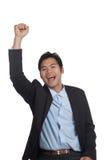 Азиатский бизнесмен счастливый делает насос кулака Стоковое фото RF