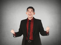 Азиатский бизнесмен счастливый Стоковые Изображения