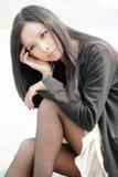 азиатский думать девушки Стоковые Изображения RF
