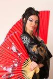 азиатский красный цвет девушки вентилятора Стоковая Фотография