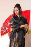 азиатский красный цвет девушки вентилятора Стоковые Фото