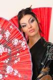 азиатский красный цвет девушки вентилятора Стоковое фото RF