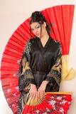 азиатский красный цвет девушки вентилятора Стоковые Изображения RF