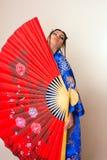 азиатский красный цвет девушки вентилятора Стоковое Фото