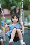 азиатский малыш играя качание Стоковое Изображение