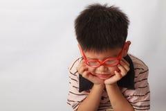 Азиатский мальчик уныло стоковое фото rf