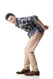 Азиатский молодой парень носит или принимает что-то стоковые изображения rf