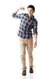 Азиатский молодой парень носит или принимает что-то стоковые фото