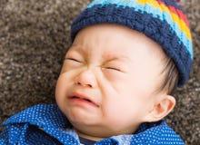 Азиатский плакать ребёнка Стоковое Изображение