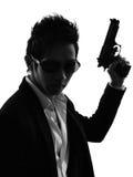 Азиатский силуэт портрета убийцы вооруженного человека стоковая фотография