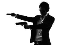 Азиатский силуэт стрельбы портрета убийцы вооруженного человека стоковые фото