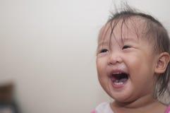 Азиатский смеяться над малыша девушки Стоковое Изображение RF