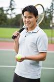азиатский теннис игрока стоковое изображение rf