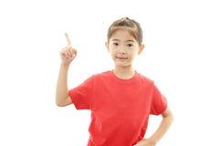 Азиатский указывать девушки стоковая фотография