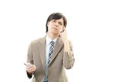 азиатский усиленный бизнесмен стоковые изображения rf