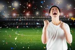 Азиатский футбольный болельщик празднует Стоковые Изображения RF