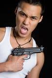 азиатский человек пушки стоковое фото