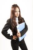азиатский черный скоросшиватель вручает ее костюм офиса повелительницы Стоковая Фотография RF