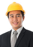Азиатский человек с шлемом безопасности стоковое изображение