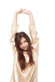 Азиатское бодрствование девушки поднимающее вверх и протягивать Стоковое Фото