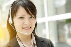 Азиатское женское работник службы рисепшн Стоковая Фотография