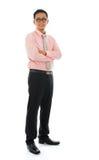 Азиатское изолированное положение бизнесмена Стоковая Фотография RF
